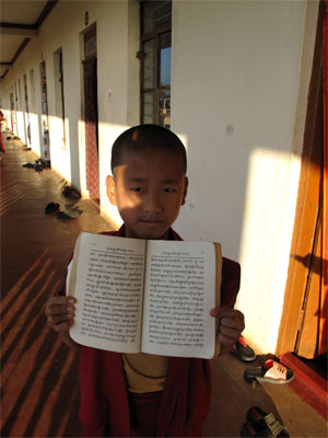 Young monk with text